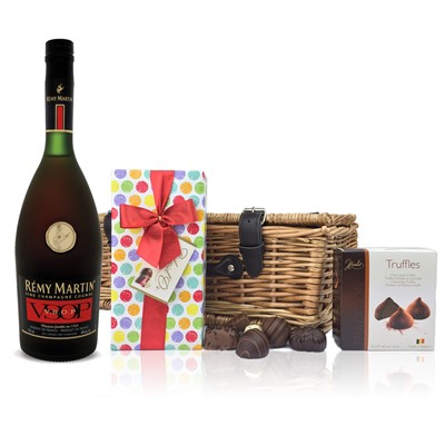 Remy Martin VSOP Hamper A fine Champagne Cognac from Remy Martin, Darker amber than the VS the VSOP with a fresh full nose with notes of vanilla limousin oak dried rose and apricot. This Hamper comes with Mini Duc d'O Belgin Chocolates 50g and Belgid'Or Fine Belgin Choclates 175g all packed in a wicker hamper with leather straps lined with wood wool. Price includes free UK Mainland Delivery, and Exports and international delivery available.