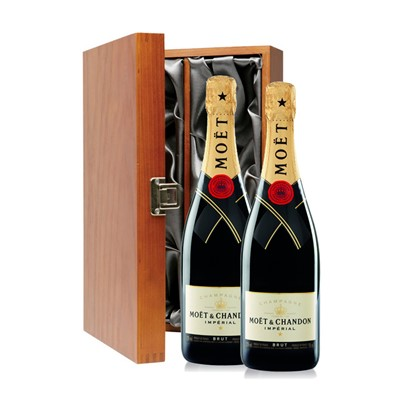 Buy Two bottles of Moet & Chandon Brut NV Champagne 2 x 75cl Presented in a luxurious stained wooden box with hinged lid and clasp. The box is lined with silver satin and comes with a Gift Card for your personal message. . Price includes free UK Mainland Delivery, and Exports and international delivery available.