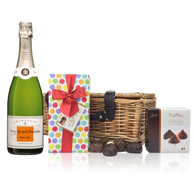 Veuve Clicquot Demi Sec and Chocolates Hamper A delightful gift of Veuve Clicquot DemiSec along with a box of Mini Duc d'O Belgin Chocolates 50g and Belgid'Or Fine Belgin Choclates 175g all packed in a wicker hamper with leather straps lined with wood wool. Price includes free UK Mainland Delivery, and Exports and international delivery available.