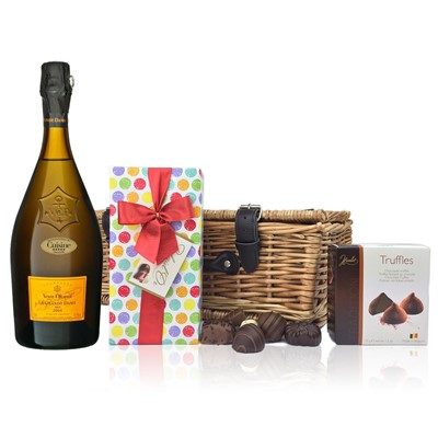 A delightful gift of Veuve Clicquot La Grande Dame along with a box of Mini Duc d'O Belgin Chocolates 50g and Belgid'Or Fine Belgin Choclates 175g all packed in a wicker hamper with leather straps lined with wood wool. Price includes free UK Mainland Delivery, and Exports and international delivery available.