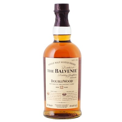 Balvenie 12 Year Old DoubleWood Speyside Single Malt Scotch Whisky  The Balvenie DoubleWood has been matured in two casks  Traditional Whisky Oak and Original Sherry Oak which results in a rich mellow flavour of great depth and unusual complexity. An exceptional single malt. Sweet fruit and Oloroso sherry notes on the nose layered with honey and vanilla. Smooth and mellow to taste with beautifully combined flavours  nutty sweetness cinnamon spiciness and a delicately proportioned layer of sherry  with a long and warming finish. Price includes free UK Mainland Delivery, and Exports and international delivery available.