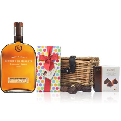 Woodford Reserve Bourbon and Chocolates Hamper A delightful gift of Woodford Reserve Bourbon along with a box of Mini Duc d'O Belgin Chocolates 50g and Belgid'Or Fine Belgin Choclates 175g all packed in a wicker hamper with leather straps lined with wood wool. All gifts come with a gift card with message of your choice.  . Price includes free UK Mainland Delivery, and Exports and international delivery available.