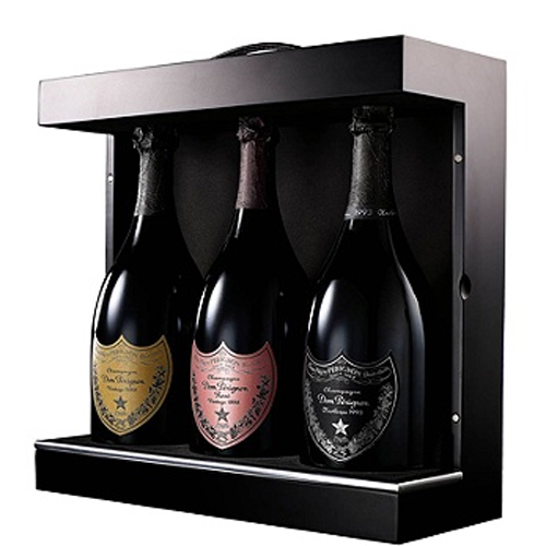The ultimate Dom Perignon Vintage Champagne Gift Set. The Power Trio is a sleek, black wooden ...